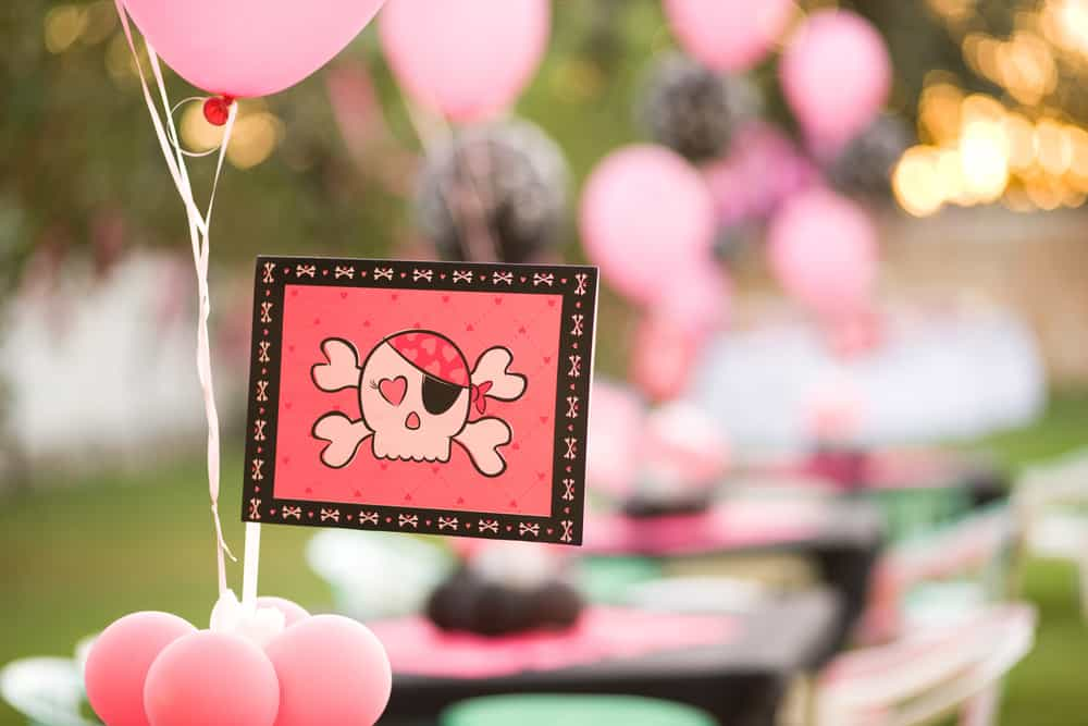 A close look at a pink pirate theme party.