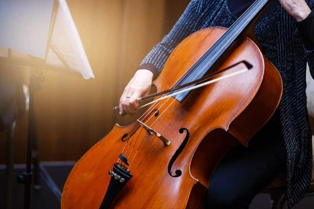 Cropped image of a woman playing a cello.
