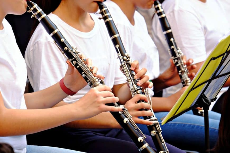 Cropped image of a band playing clarinets.