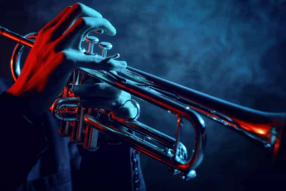 Jazz player playing a bass trumpet.