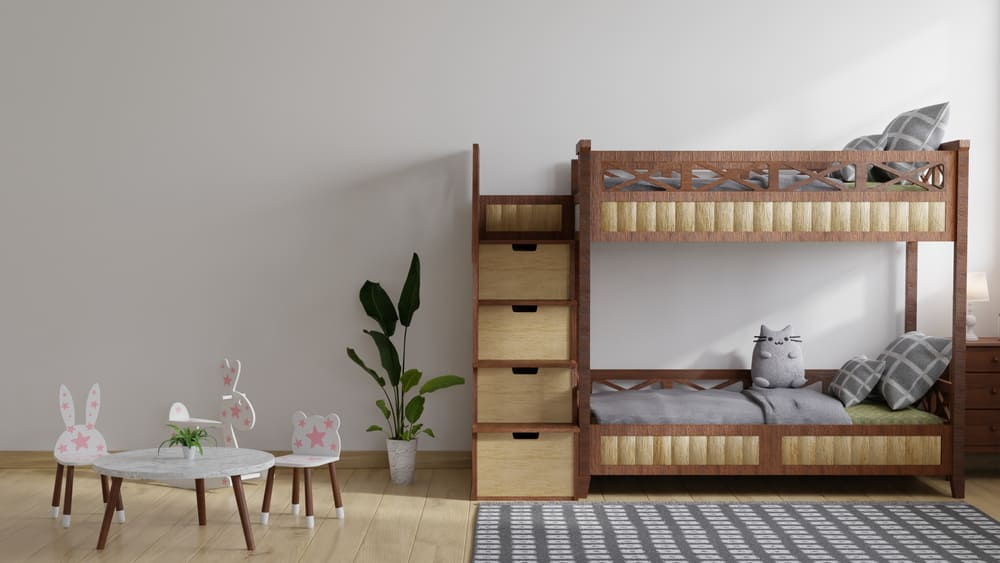 Kid's bedroom with a wooden bunk bed, a marble table, and a checkered area rug.