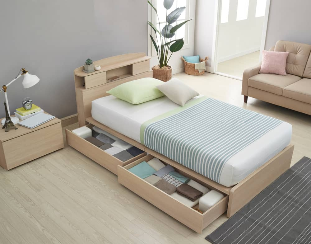 Modern bedroom with a cabin bed paired with a matching nightstand.