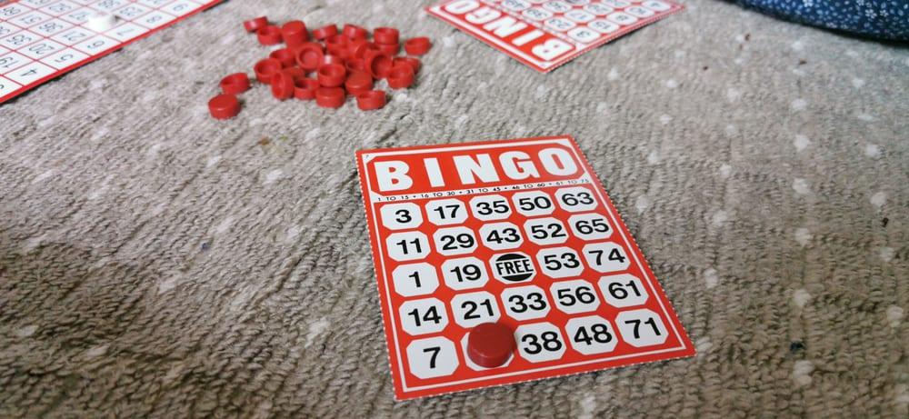 Red bingo cards over a carpet.