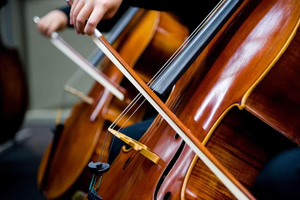 Closeup of the cello bows while a band plays cello.