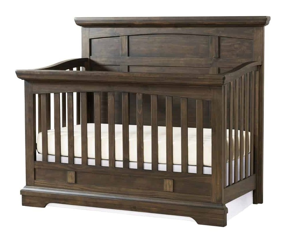 Convertible crib made in dark wood.
