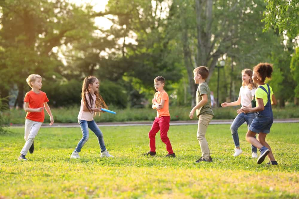 Children playing frisbee outdoors.