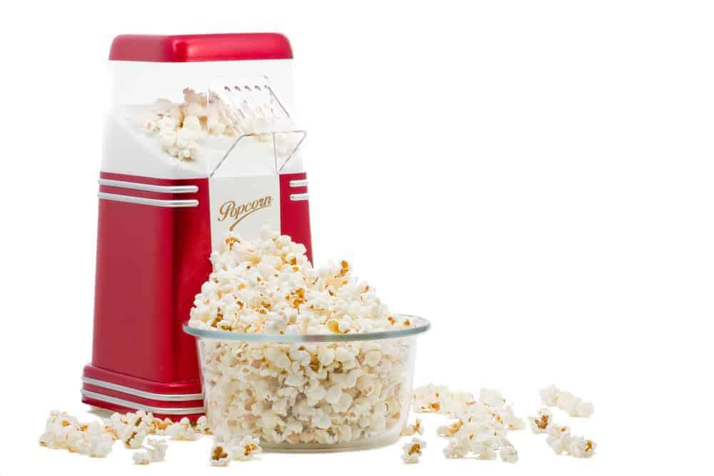 Hot Air Popcorn Maker beside a bowl of popcorn.