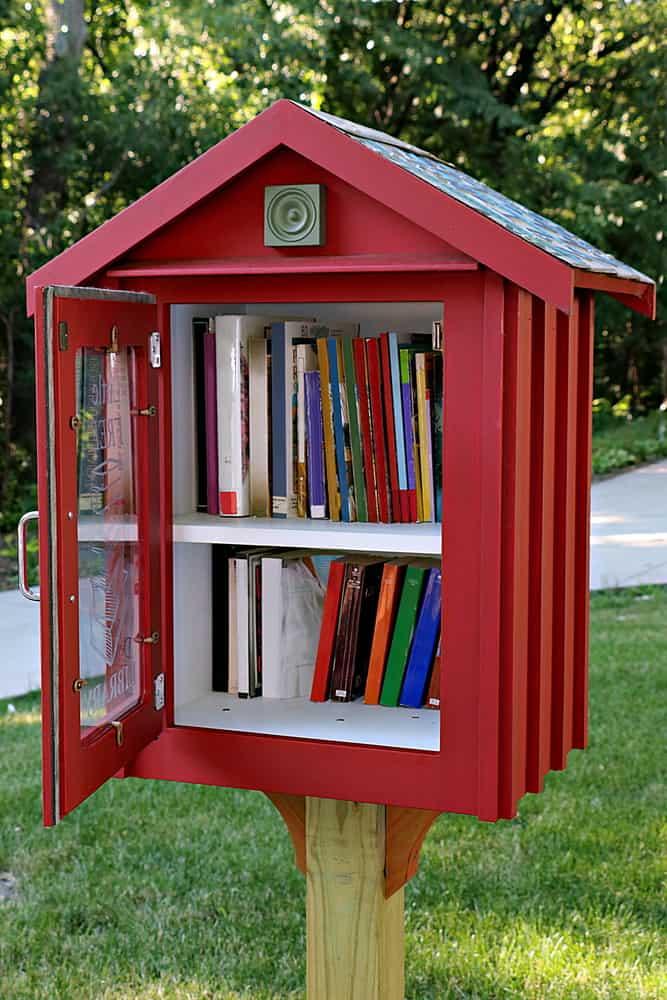 Sidewalk library in residential neighborhood.