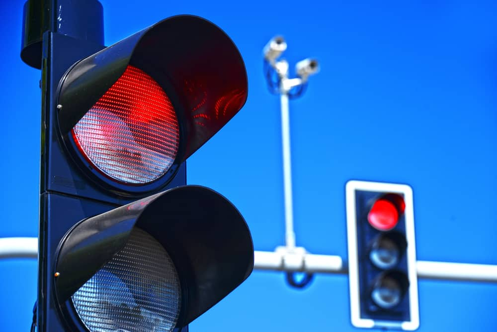 Traffic lights against the clear blue sky.