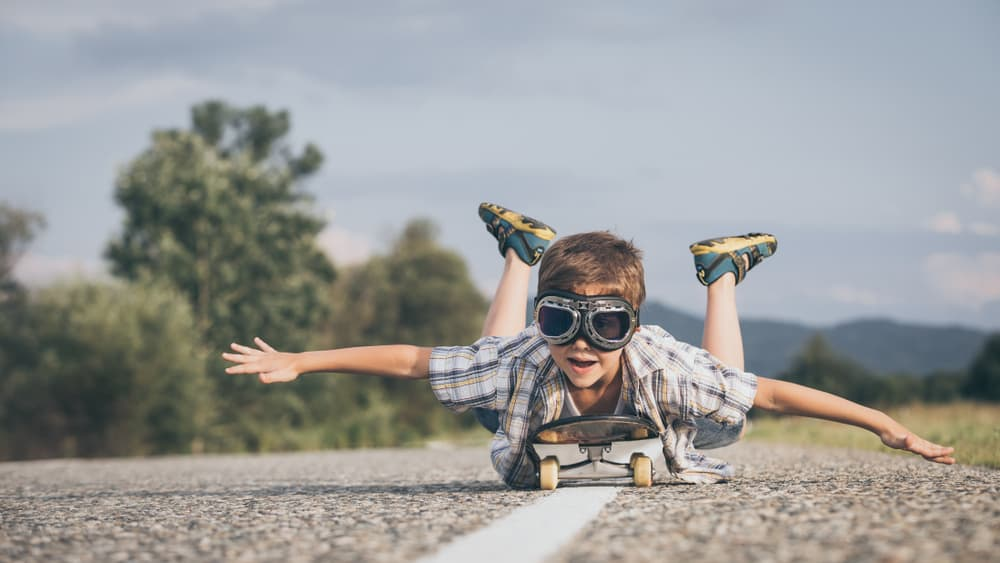 Boy riding a skateboard on the road.