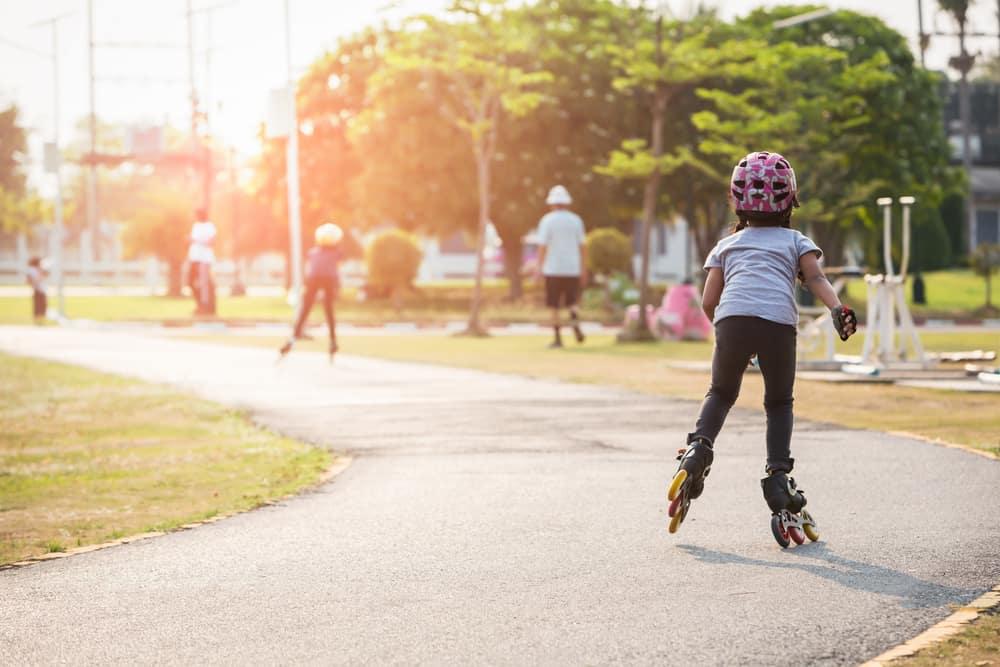 Kids roller skate in the park.