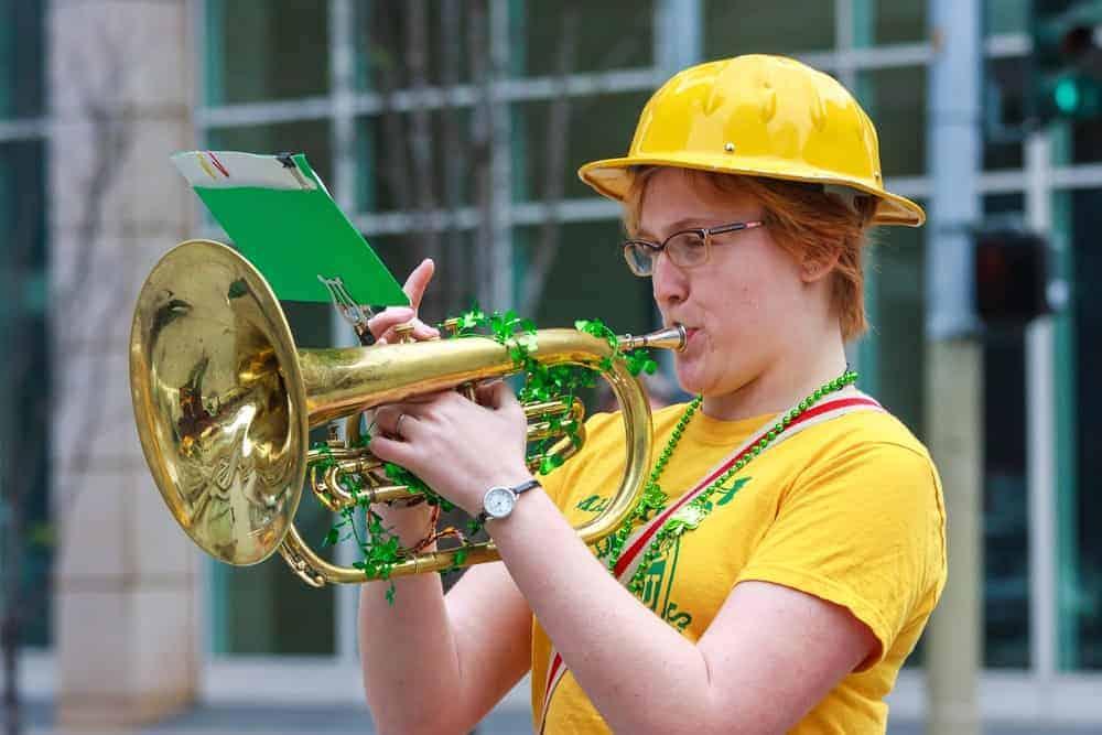 Woman playing a saxhorn.