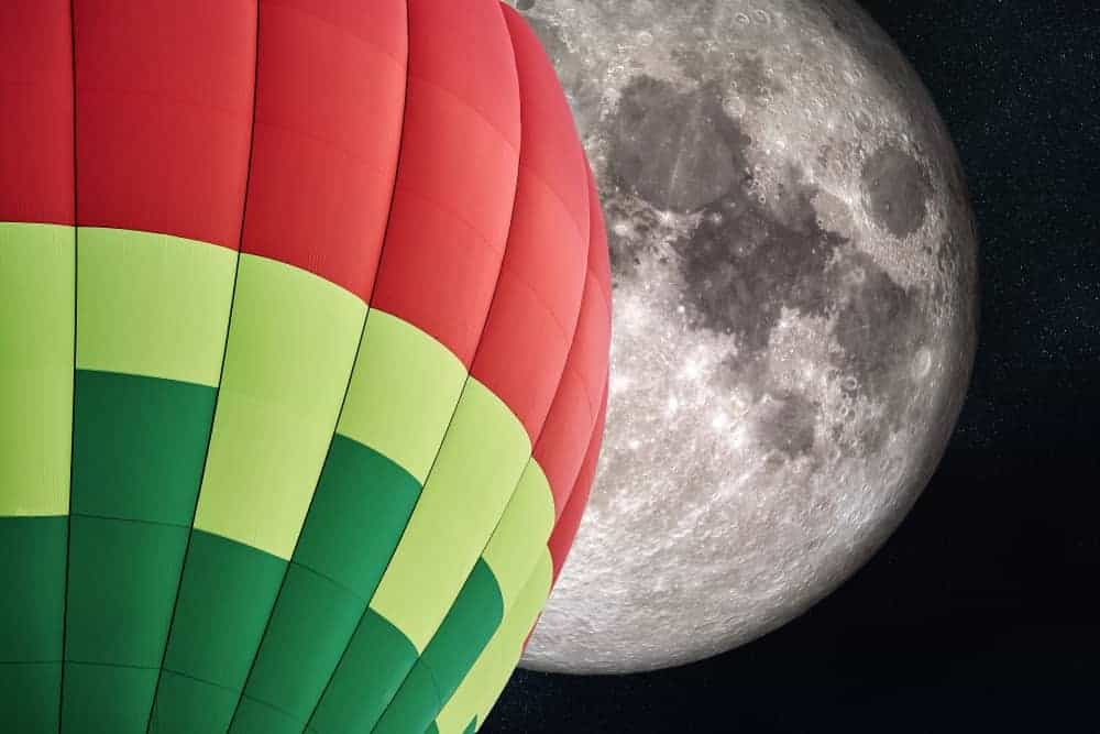 Balloon against an image of the moon.