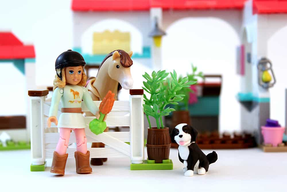 This is a close look at a Mega Construx toys with a girl, a dog and a horse.