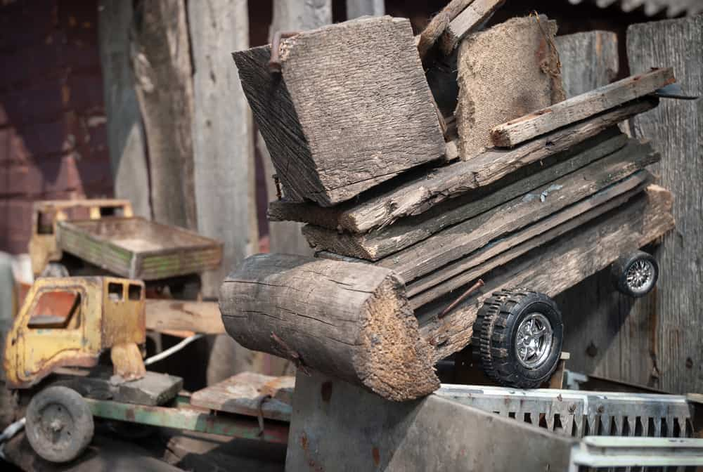 This is a close look at a homemade wooden toy truck.