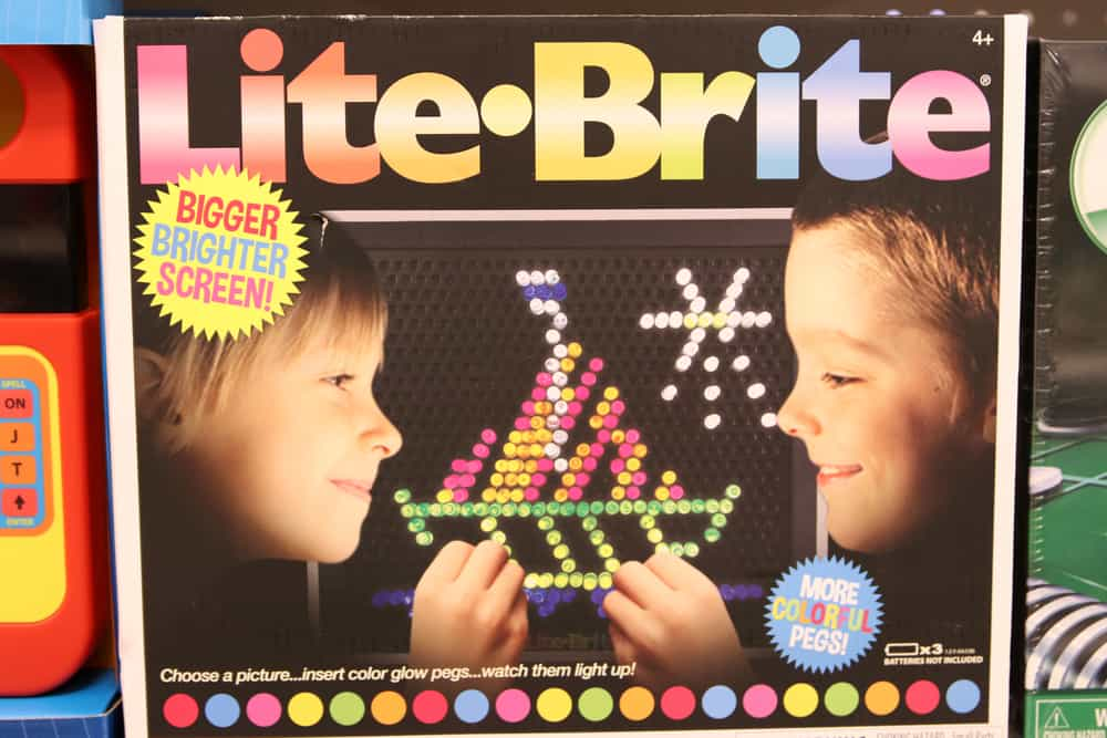 The box of the original Lite Brite toy on display at a toy store.