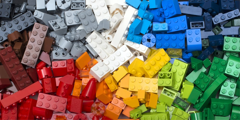 This is a close look at a collection of colorful Lego pieces.