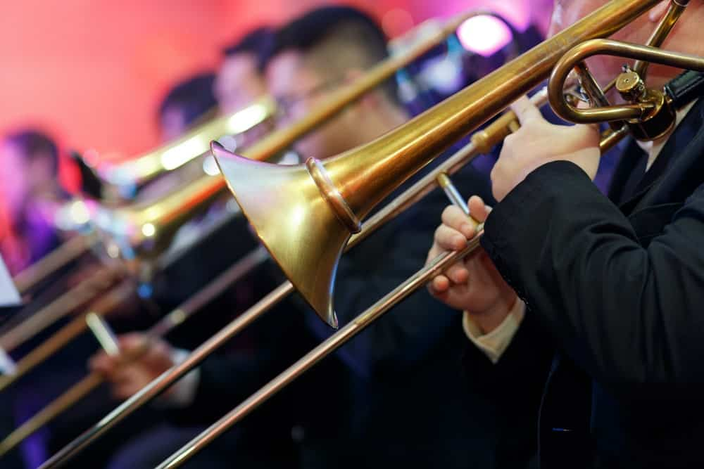 Cropped closeup image of a trombone during a band play.