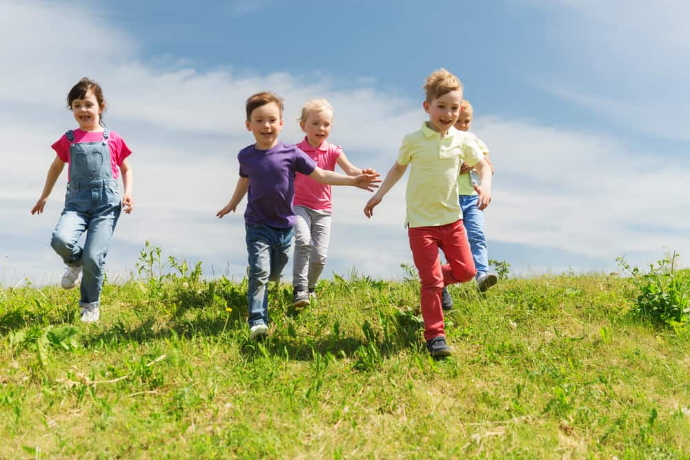 A group of kids playing outdoors.