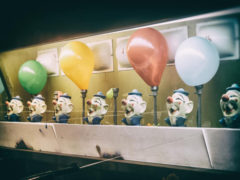 This is a close look at a carnival game with balloons.