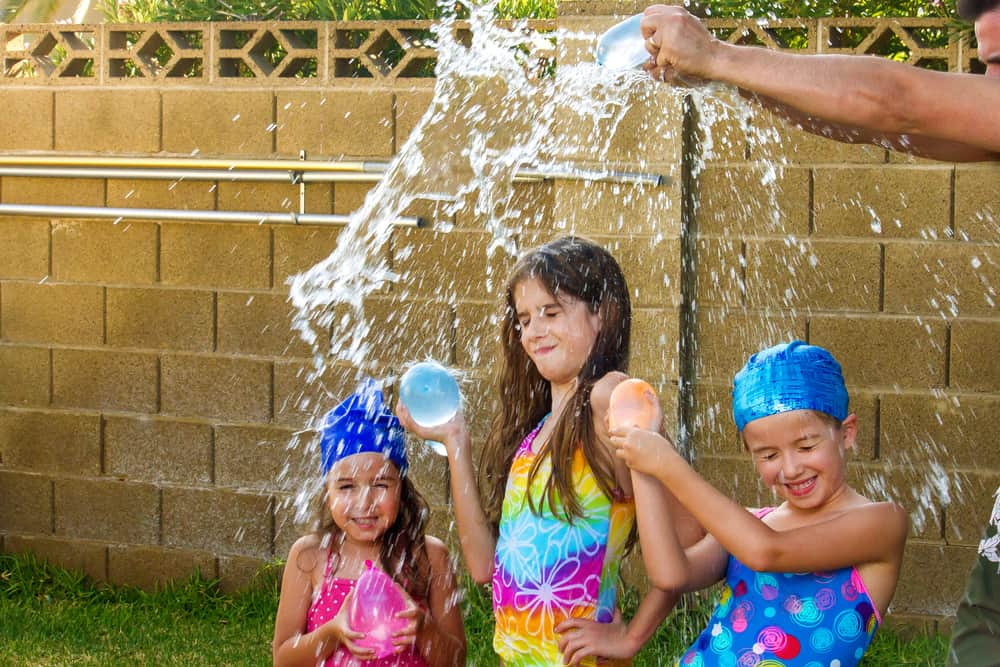 Kids playing with water balloons.