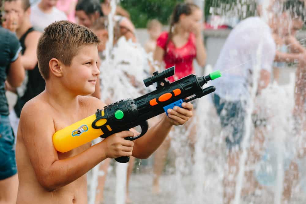 This is a kid playing with a squirt gun.