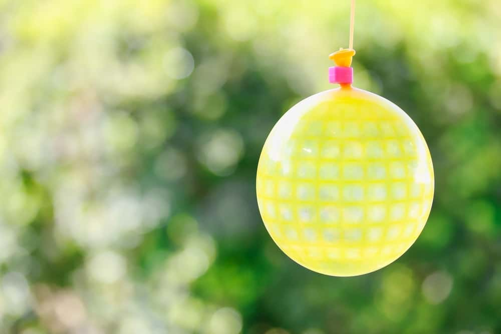 This is a close look at a yellow patterned water balloon pinata.