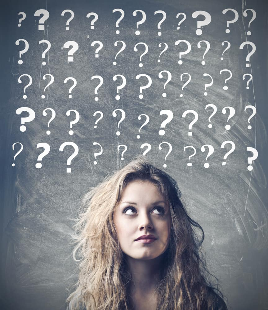 A confused teen girl with various question marks above her head.