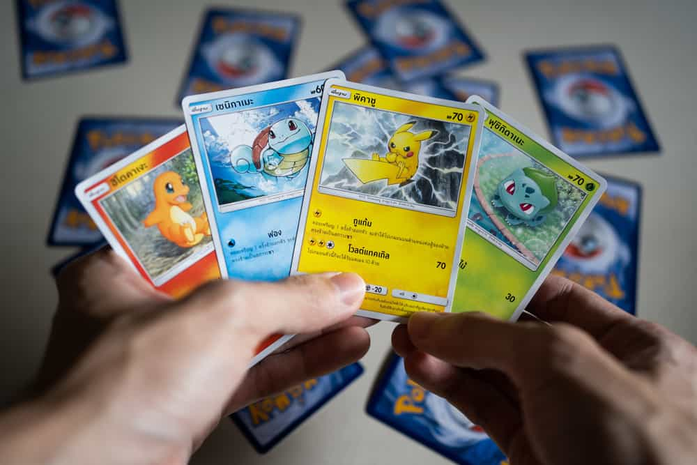 Original Pokemon cards in hand.