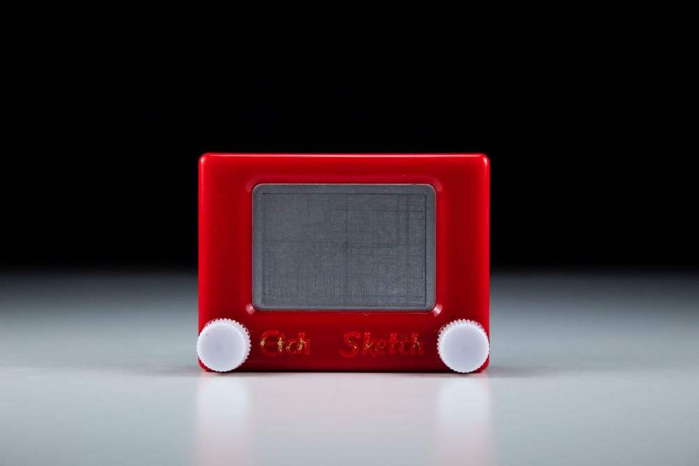 This is a vintage Etch a Sketch plastic toy.