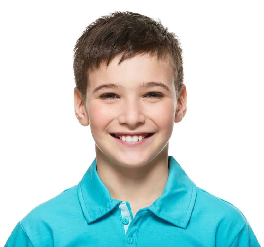 A smiling ten-year-old boy wearing a blue collared polo shirt.