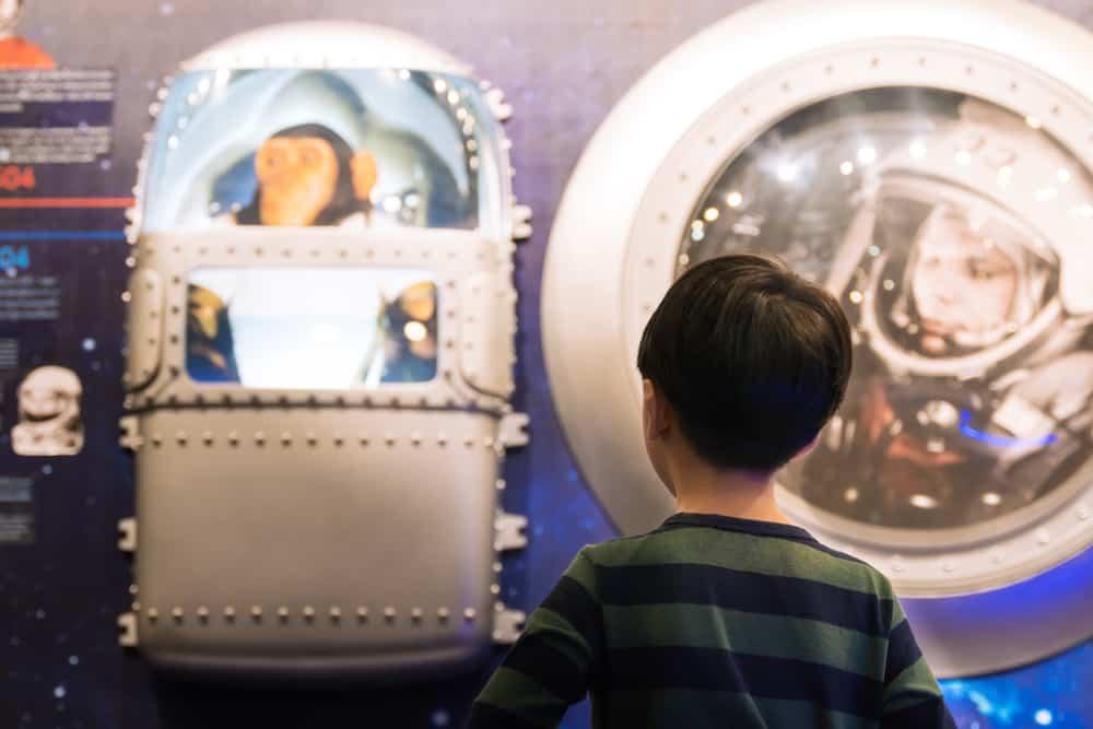 Little boy looking at Yuri Gagarin, soviet astronaut and rhesus monkey, Albert, board in Space Inspirium museum.