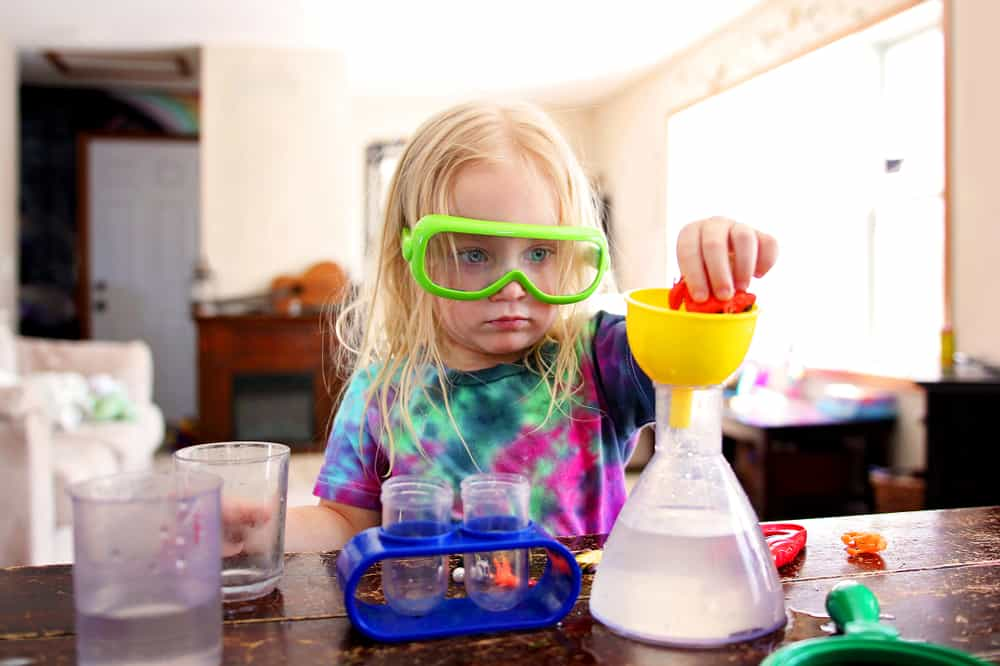 Little girl doing a science experiment at home.