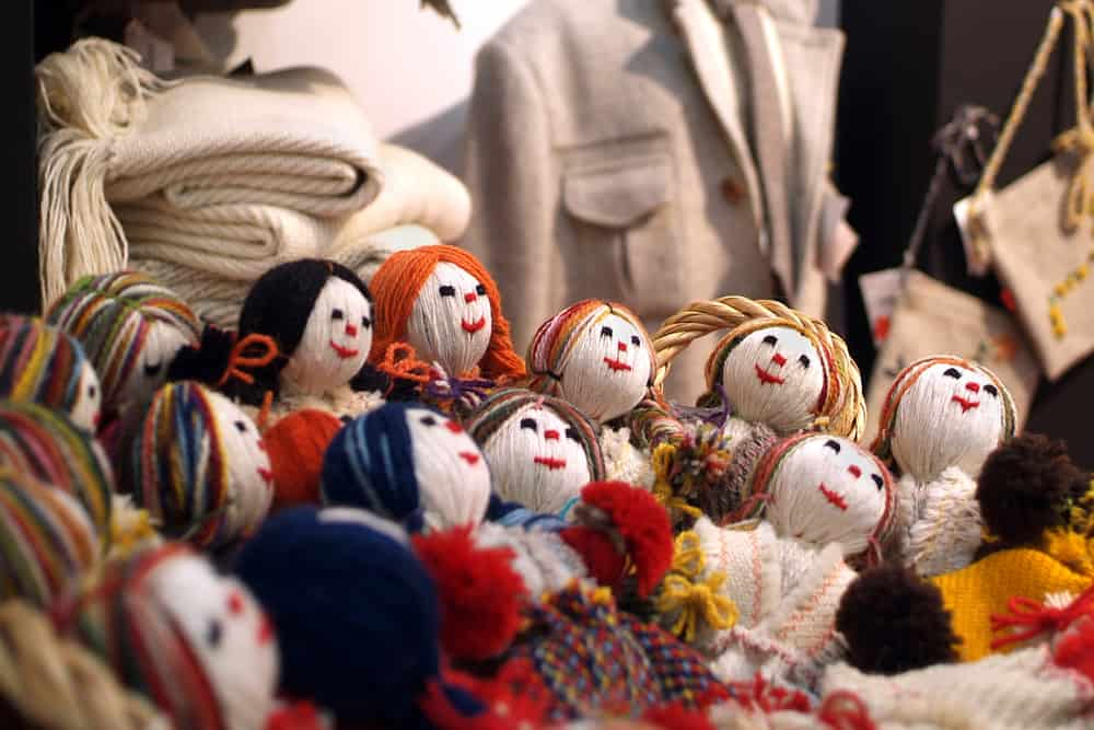 A bunch of weaving dolls placed in the closet.